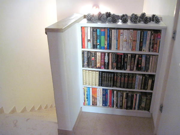 Built In Bookshelf In A Stair Landing Alcove